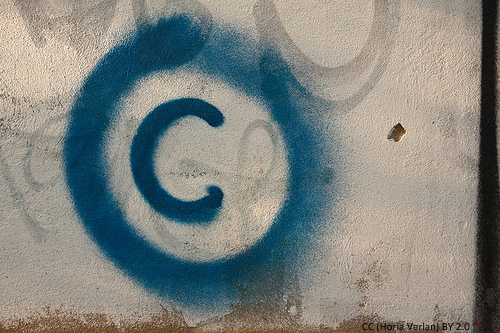 Large copyright graffiti sign on cream colored wall